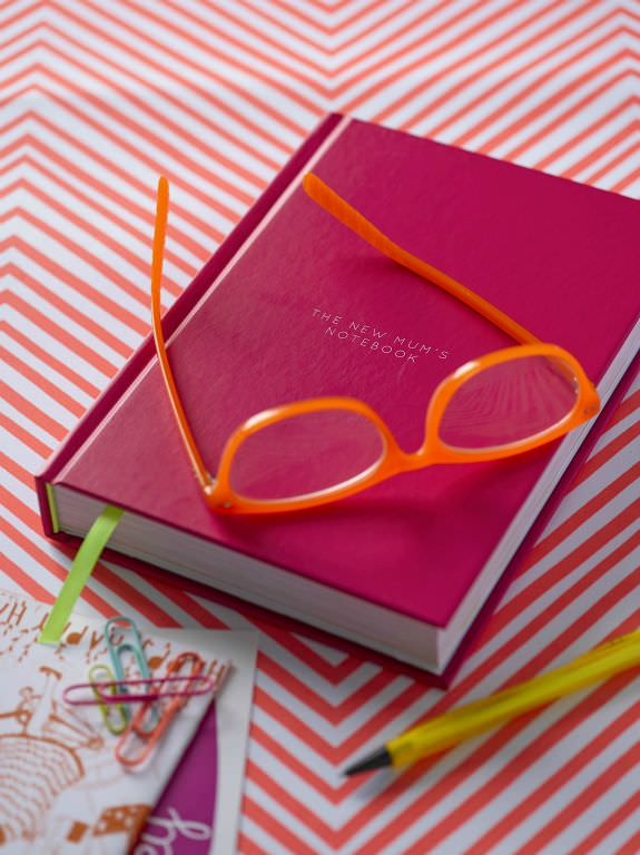 book-with-neon-glasses